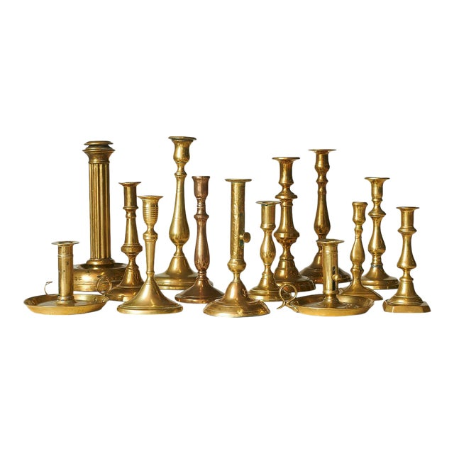 A Collection of sixteen brass candle sticks, various sizes and shapes. For Sale