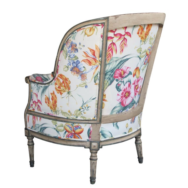 The sumptuous, generously proportioned bergere in a nicely patinated painted finish; newly upholstered with down seat cushion