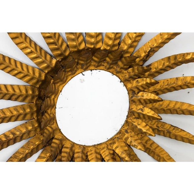 Spanish sunburst mirror, circa early 20th century. Please note that the mirror itself has wear consistent with age.