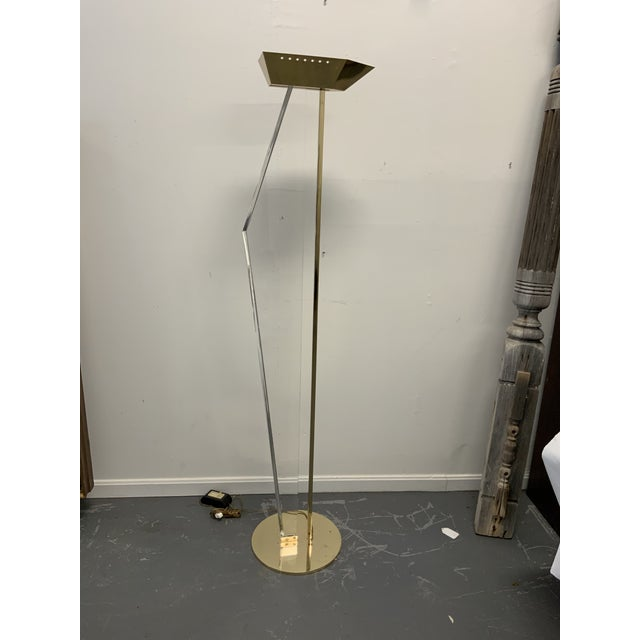 Mid-Century Modern Lucite and Brass Floor lamp. Brass base.