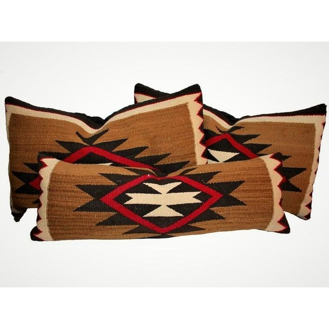 These early saddle blanket weaving bolster pillows are in great condition and have black cotton linen backings. These...
