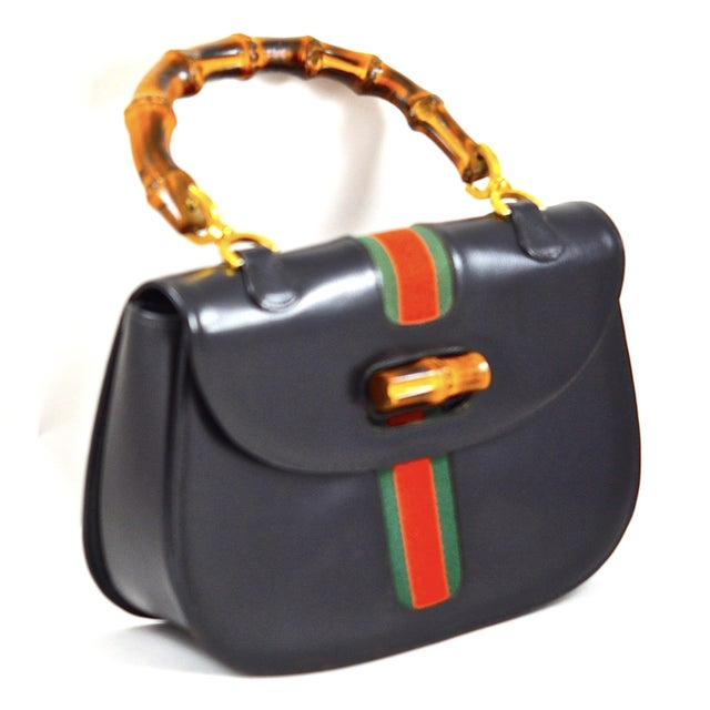 Iconic 1960s style by Gucci but manufactured for Saks Fifth Avenue's private label. Please note that the bag is officially...