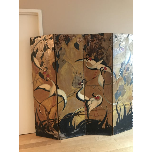 A unique 4 panel oriental style room divider. Hand painted in rich gold, red and burnt tones. perfectly aged and worn. A...