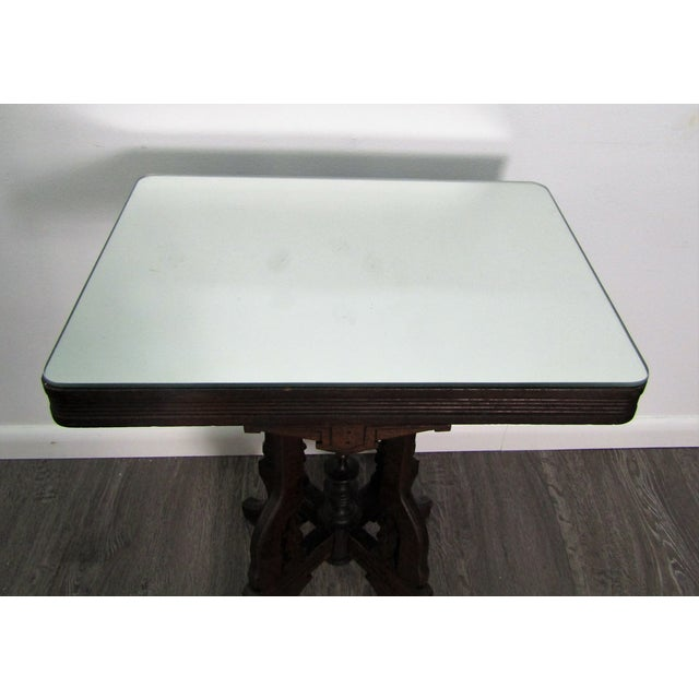 Antique pedestal accent side table with mirror top. The table features a pedestal base , wood carved with exceptional...