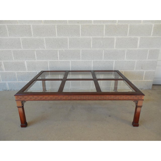 Kindel Chippendale Style Mahogany Coffee Table in Oxford Finish Features high quality solid construction. Fixed beveled...