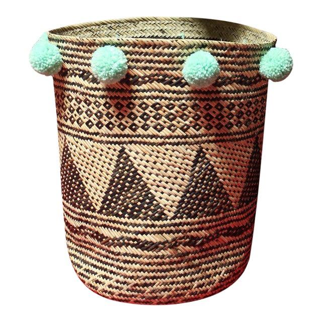 Borneo Drum Tribal Straw Basket with Mint Pom-poms - Image 1 of 5