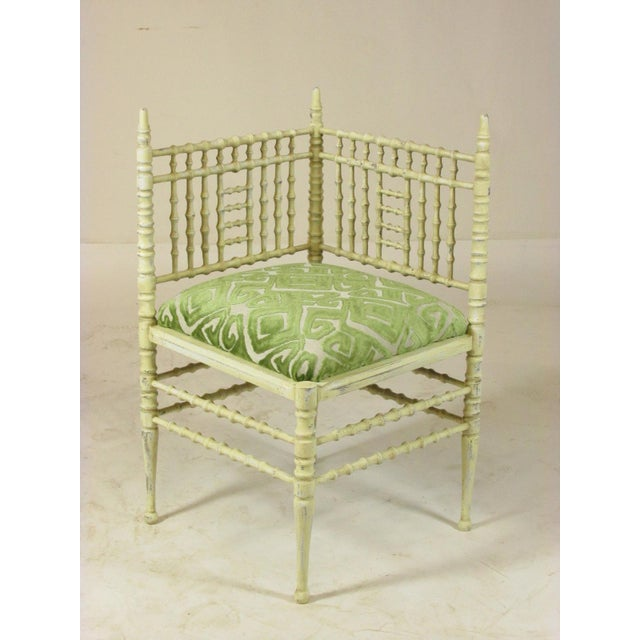 A pair of late 19th-C. French painted corner chairs with faux bamboo detail and new upholstery with custom fabric. Seat,...
