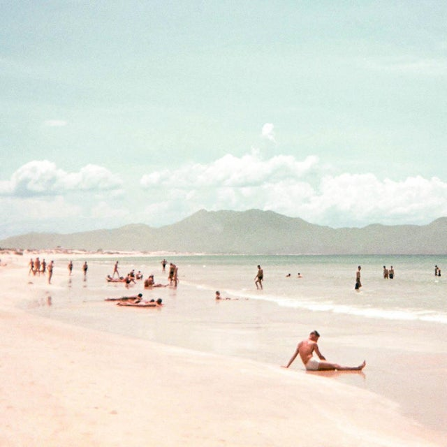 This is a film photograph of Cam Rahn Bay, Vietnam during the 1960s. The Lyon + Finch Found Artwork Collection is sourced...
