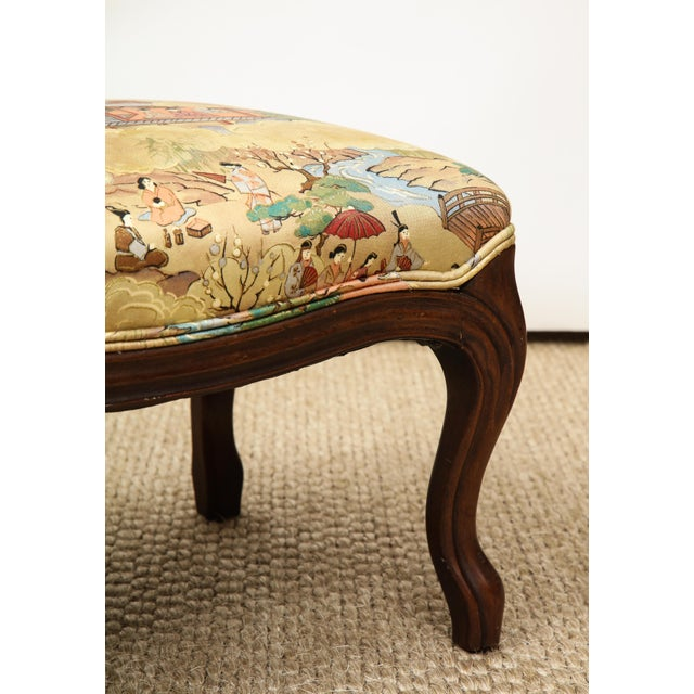 This Louis XV style footstool has cabriole legs and is upholstered in a chinoiserie motif silk. A perfect layering piece...