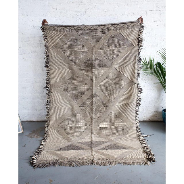 Double sided rug featuring one side lighter ivory tones and the other side the darker tones. Flat-woven 100% wool handmade...