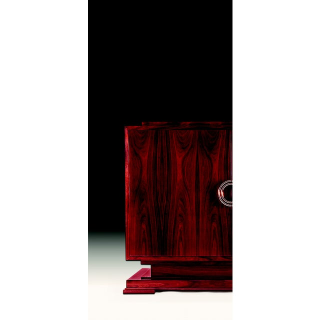 Figured Macassar Ebony provides rich surface interest to this well proportioned large door cabinet. An elegant symmetry is...