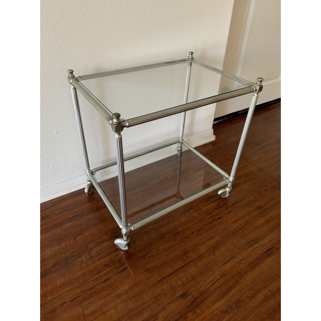 Rolling nickel vintage bar cart made in Italy. Beautiful patina, rolls smoothly and has a very small corner chip on bottom...