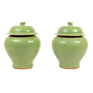 Vintage Chinese Elephant Topped Celadon Porcelain Jars - a Pair For Sale