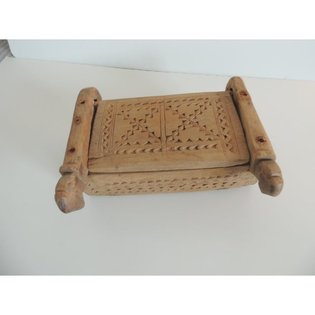 Vintage Indian market hand carved wooden box with lid and carving details. Compartments insize, carved out of a solid wood...