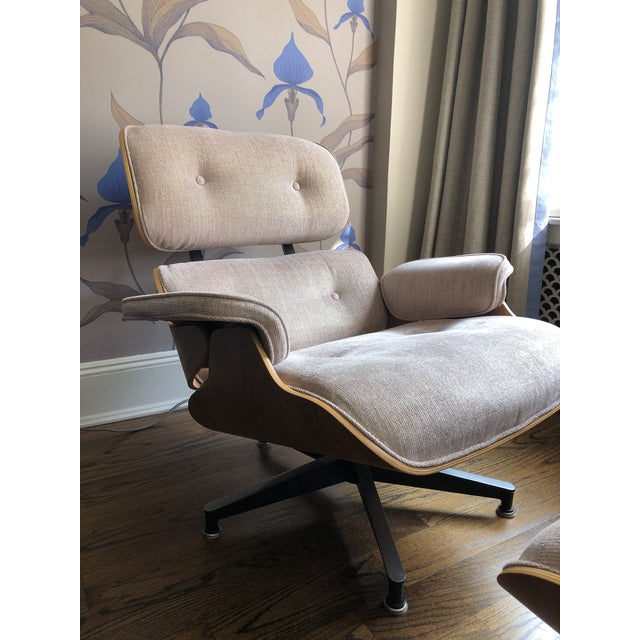 Iconic Eames lounge chair and ottoman reupholstered in a modern and feminine Osbourne & Little fabric. Fabric is a rose...