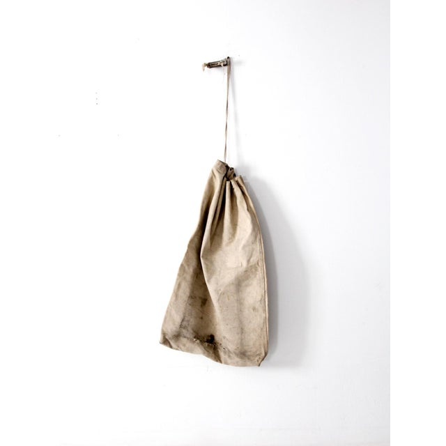 This is a vintage Northwestern Telephone Company bag. The large white canvas bag has a drawstring rope closure with metal...