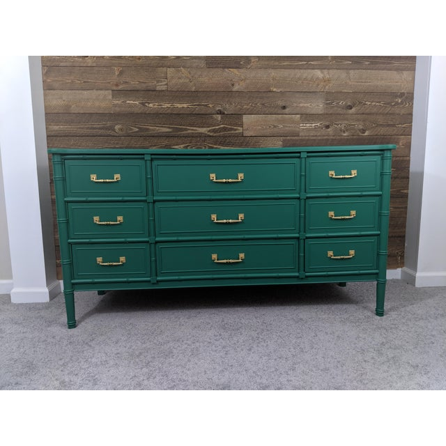 Up for sale is a Beautiful emerald green Bali Hai Faux Bamboo Dresser. Gold handles Vintage