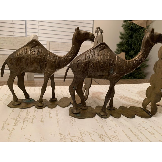 Vintage mid-century heavy Egyptian-style camel bookends with a lot of intricate ornamental carvings. I believe artisan-...