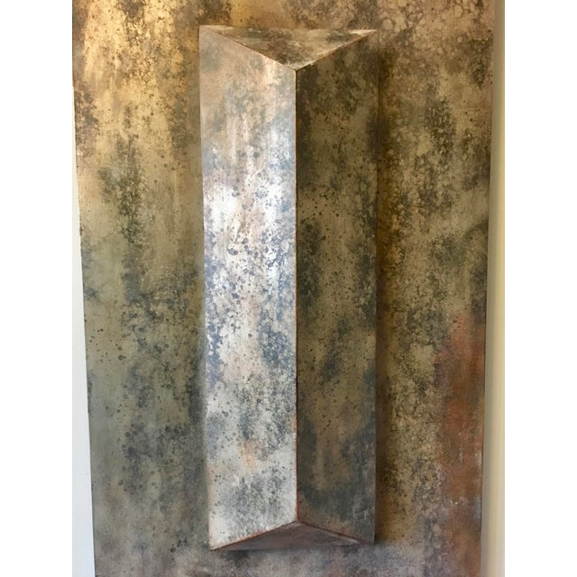 The architectural lines of this modern wall sculpture will fit in any home classic or contemporary. The iron looking panel...