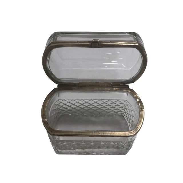 A Baccarat cut crystal box with a curved shape, cut crystal bottom and clear beveled top. Gilt mounts, circa 19th century...