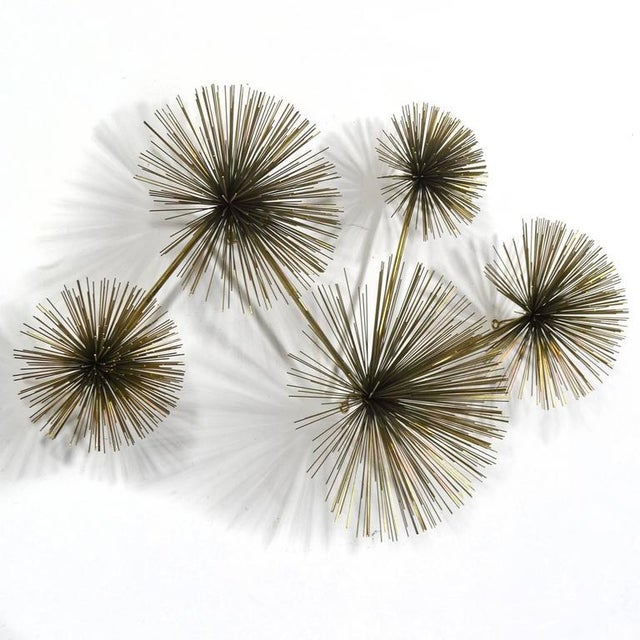 The Jere studio created a variety of designs using Bertoia's dandelion form as inspiration. This wall-mounted sculpture...