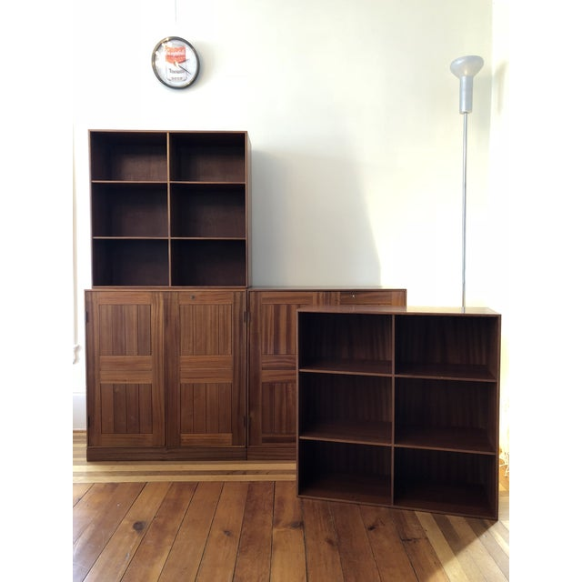 Mogens Koch Cabinets with bookcase units for Rud. Rasmussens, in Cuban Mahogany. Denmark, 1950s. All 4pcs pieces have...