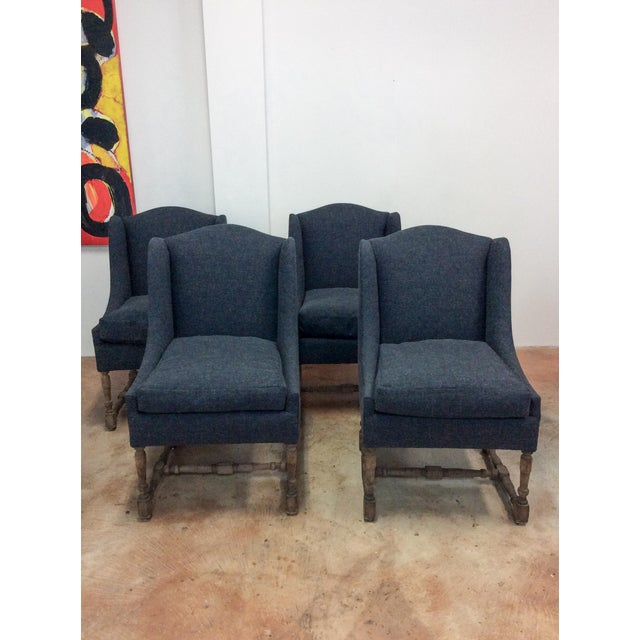 Set of four newly re-upholstered armless chairs. Slightly desaturated navy blue heavy cotton fabric. Decorative wood legs....