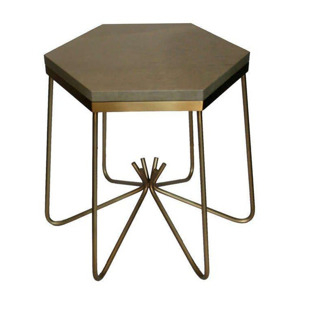 Sculptural bronze rod sculptural side table with calf leather hexagon top. Custom orders have a lead time of 10-12 weeks...