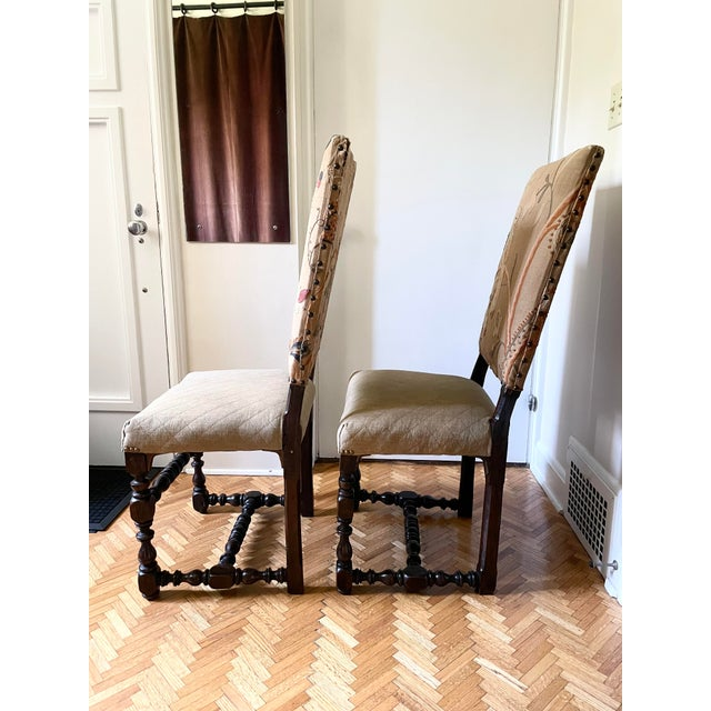Antique Pair of Upholstered Walnut Mid 17th Century Louis XIII Style Baroque Fireside Chairs. The backs retain late 19th...