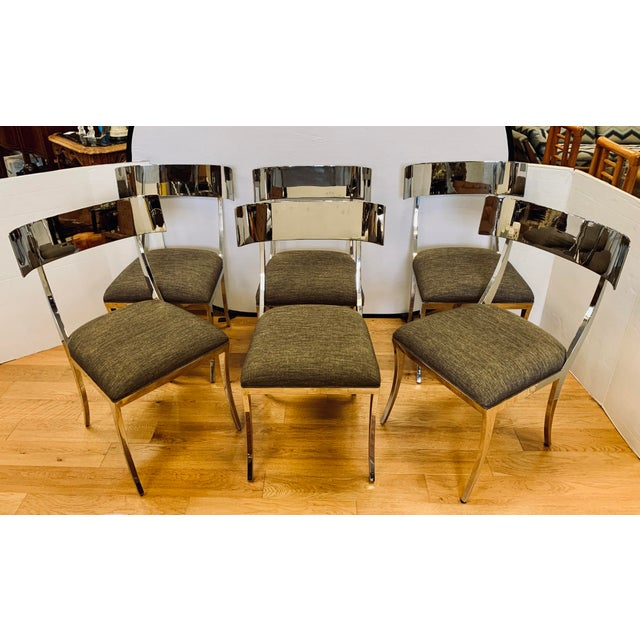 Very sleek neoclassical style polished chrome klismos chairs with upholstered dark gray linen seat. Sexy, beautiful curves...