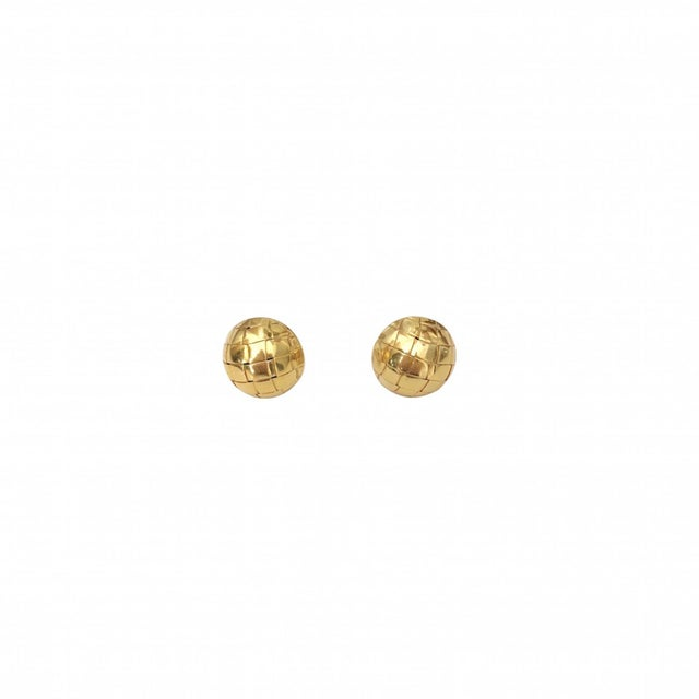 A fine classic pair of 18K yellow gold earrings, Italian in origin. The half dome pierced post earrings have a basket...