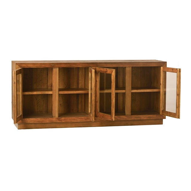 The glass doors of this attractive sideboard make it a great choice for storing dishes or collectibles. With four doors...