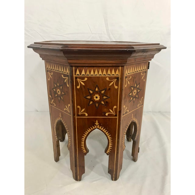 For follows function in this very cool inlaid Syrian octagonal traveling table. Lift the top off and Viola! it folds flat...
