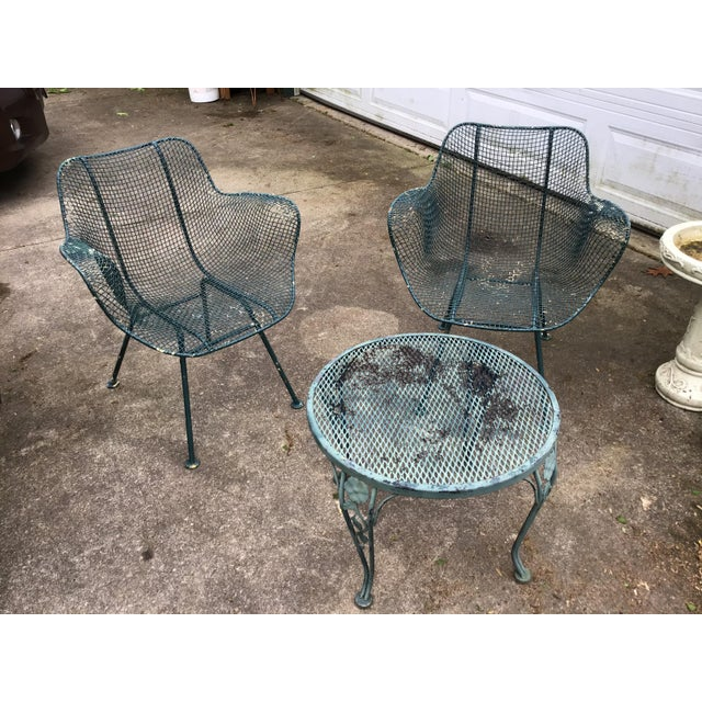 Sculptura chair a pair by Russell Woodard. Wrought iron with mesh design. Features small green round side table with...