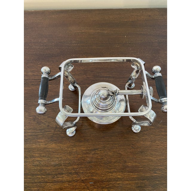 This little treasure gives sterno a new look. If you like entertaining you must have this. An antique English silver plate...