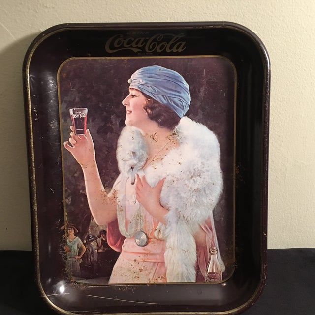 This fantastic original Coca-Cola tray depicting a 20's well dressed woman enjoying a Coke. A find from a Miami estate.