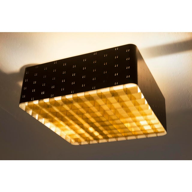 "Paavo Tynell ceiling lamp model # 9068 ""Starry Sky"" by Idman Oy. Black shade with glass diffuser and brass grid. Finland,..."