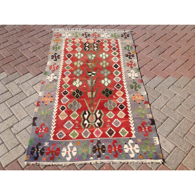 This beautiful, vintage, handwoven kilim is approximately 60 years old. It is handmade of wool and cotton in all natural...