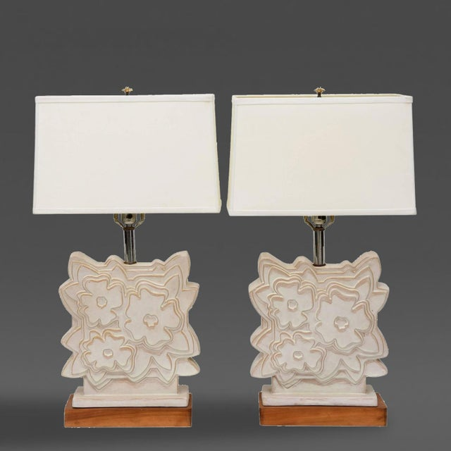 Pair of Italian modern ceramic lamps. Each in stylized floral motif, stamped Raymor.