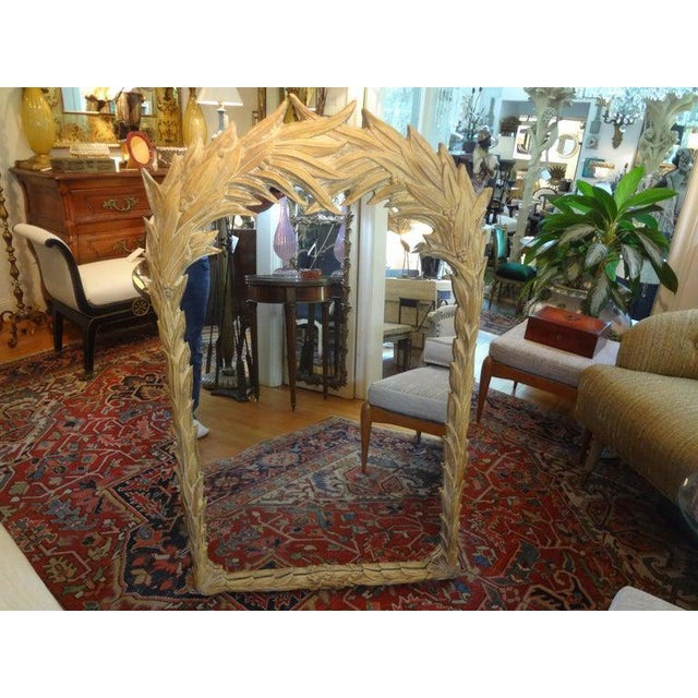 Great midcentury Serge Roche style palm frond mirror. This beautiful Hollywood Regency tropical palm beach style mirror is...