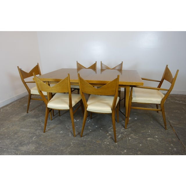 This dining set was designed by Paul McCobb for the Calvin Group. It comes with two armchairs, four side chairs and two...