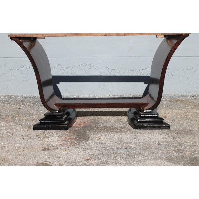 A stunning c1930's french art deco exotic macassar ebony grand dining table and may be used as a desk. Curved form with...
