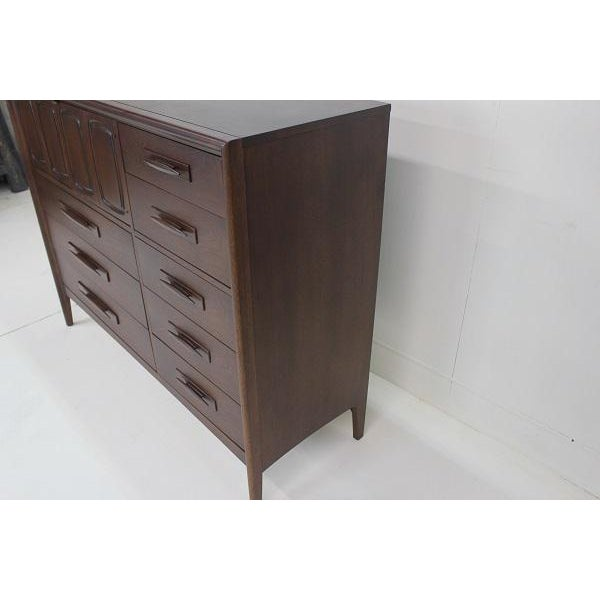 This Broyhill Emphasis Magna High Dresser has been restored in a dark brown color and had a ton of storage.