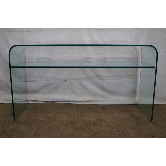 Mid-Century Modern Curved Glass Console with Shelf. AGE/COUNTRY OF ORIGIN: Approx 25 years, Italy DETAILS/DESCRIPTION:...