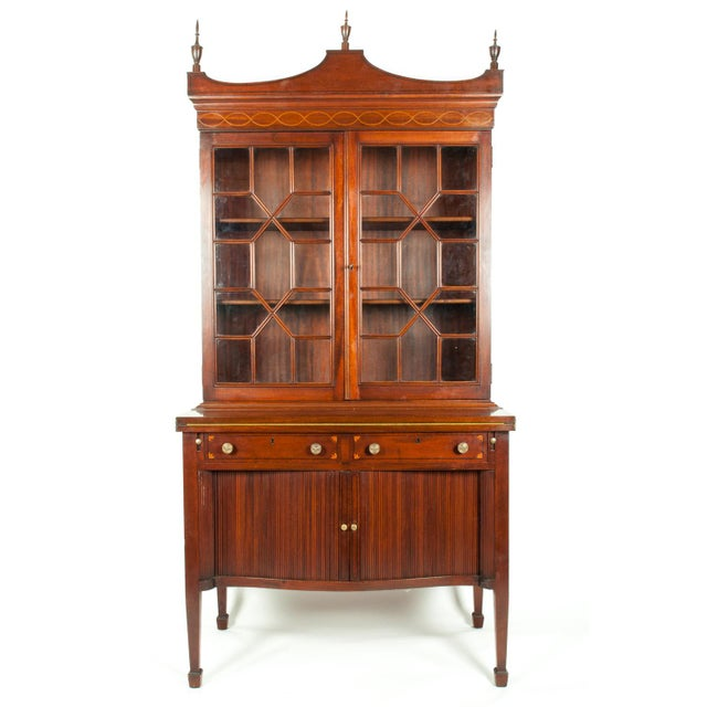 Charak hand-carved two-piece mahogany display cabinet with intricate design details. The piece is in excellent vintage...
