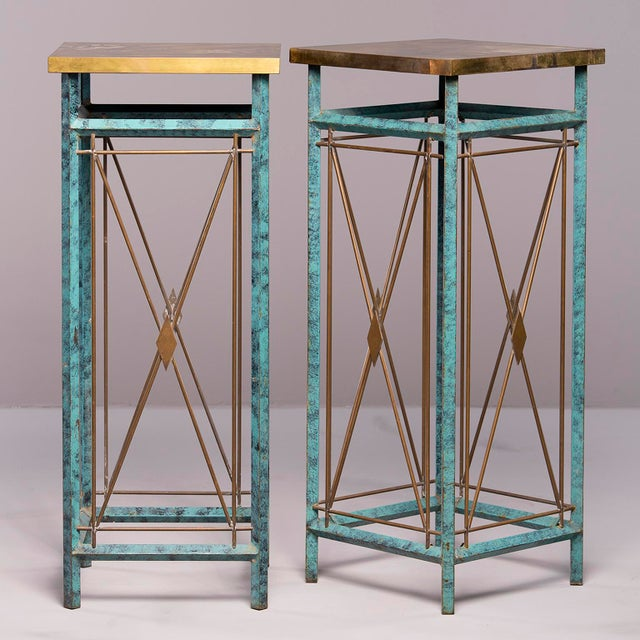 Pair circa 1960s tall metal statue or plant stands feature verde green legs with contrasting brass x-form cross pieces...