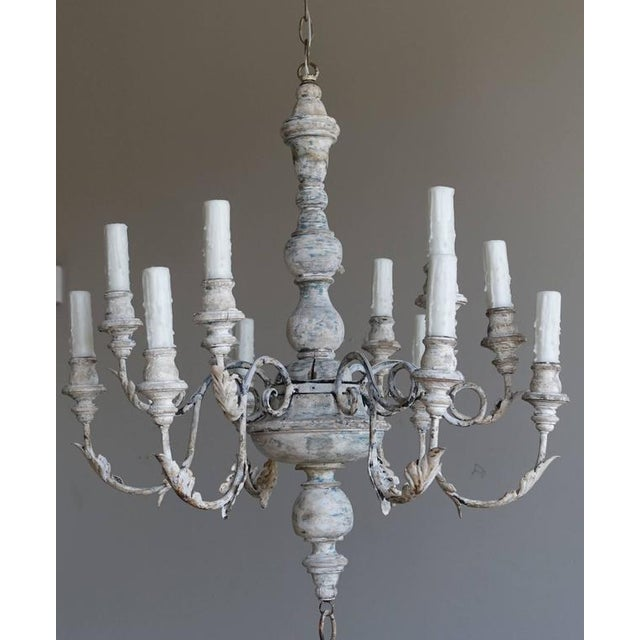 """Italian twelve-light wood and iron chandelier newly wired with drip wax cream candle covers. Chandelier includes 40"""" of..."""