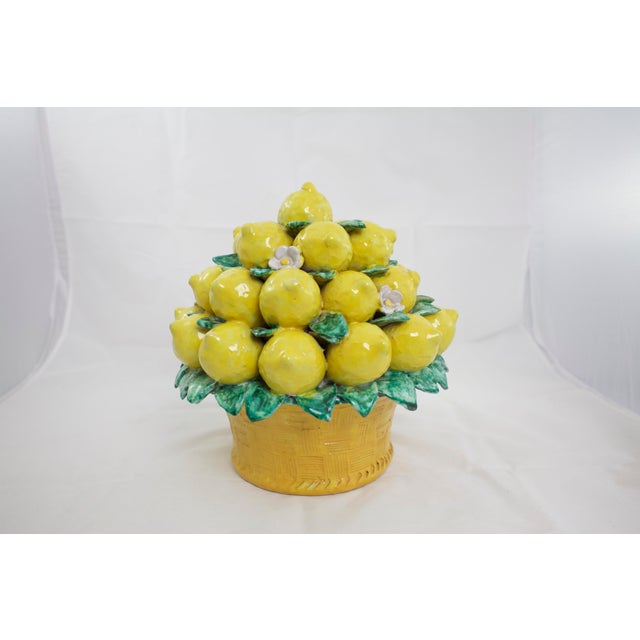 """Italian majolica terracotta pottery lemon topiary. Signed """"Neiman Marcus Made in Italy"""". Chips to 2 leaves."""