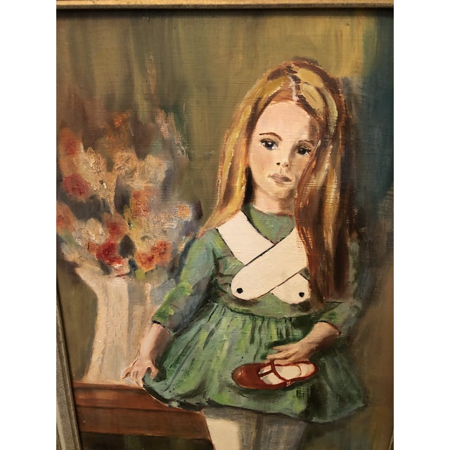 Vintage framed painted portrait of small girl holding her shoe. Unsigned but marked on the back names of who it was from...