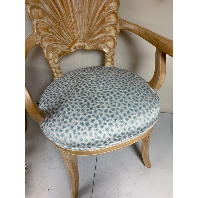 This pair of Italian shell backed chairs have a bleached pine finish that is original and new leopard upholstery with...
